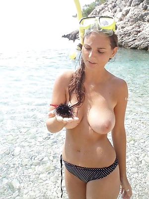 Naked beach babes. Topless babes on beach pics. Enjoy.